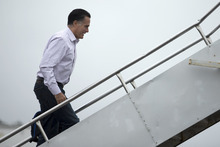 Republican presidential candidate, former Massachusetts Gov. Mitt Romney boards his campaign plane, Tuesday, Oct. 9, 2012, in Newport News, Va.  (AP Photo/ Evan Vucci)