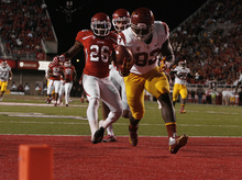 Scott Sommerdorf  |  The Salt Lake Tribune              USC tight end Randall Telfer (82) scores a 23-yard touchdown with Utah defensive back Ryan Lacy (26) trailing the play on Oct. 4, 2012.
