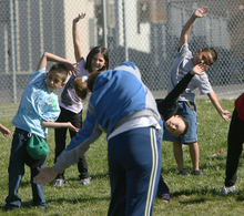 Steve Griffin | The Salt Lake Tribune   Third-graders at Westbrook Elementary School stretch before they run as part of Westbrook PTA's third annual