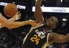 Utah Jazz Paul Millsap loses control of the ball to Golden State Warriors' David Lee during the second half of a preseason NBA basketball game in Oakland, Calif., Monday, Oct. 8, 2012. (AP Photo/George Nikitin)