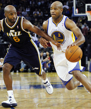 Golden State Warriors' Jarrett Jack (2) drives for the basket as Utah Jazz's Jamaal Tinsley (6) defends during the first half of a preseason NBA basketball game in Oakland, Calif., Monday, Oct. 8, 2012. (AP Photo/George Nikitin)