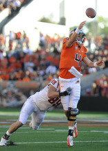 Oregon State's Sean Mannion (4) throws against Washington State's Travis Long (89) during the first half of an NCAA college football game in Corvallis, Ore., Saturday, Oct. 6, 2012. (AP Photo/Greg Wahl-Stephens)