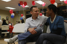 Chris Detrick  |  Tribune file photo Mia Love and her husband Jason Love talk at the Avondale Academy in this 2009 photo.