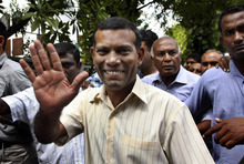 FILE - In this Feb. 10, 2012 file photo, Maldives' former President Mohamed Nasheed waves as he walks back home after prayers in Male, Maldives. Police in the Maldives arrested Nasheed on Monday, Oct. 8, 2012, after he twice failed to appear before a court to face charges that he illegally ordered the arrest of a judge while in office. (AP Photo/Sinan Hussain, File)