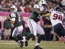 New York Jets quarterback Mark Sanchez looks to pass as tackle D'Brickashaw Ferguson (60) blocks  Connor Barwin (98)during the first half of an NFL football game Monday, Oct. 8, 2012, in East Rutherford, N.J. (AP Photo/Kathy Willens)