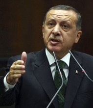 Turkish Prime Minister Recep Tayyip Erdogan addresses the legislators of his ruling party in parliament in Ankara, Turkey, Tuesday, Oct. 9, 2012. Erdogan said Turkey was prepared to counter any threats from Syria.