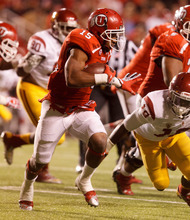 Trent Nelson  |  The Salt Lake Tribune Utah running back John White (15) runs the ball against USC during a game Oct. 4, 2012 at Rice-Eccles Stadium in Salt Lake City.