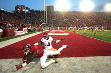 Utah wide receiver Kenneth Scott (2) grabs a touch down catch as Southern California cornerback Torin Harris (4) defends in the first quarter during an NCAA college football game Thursday, Oct. 4, 2012, in Salt Lake City.  (AP Photo/Rick Bowmer)