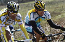 FILE - This March 21, 2009 file photo shows Lance Armstrong, of the United States, beside fellow countryman George Hincapie, left, during the Milan-San Remo cycling classic in San Remo, Italy. The U.S. Anti-Doping Agency says 11 of Lance Armstrong's former teammates testified against him in its investigation of the cyclist, revealing