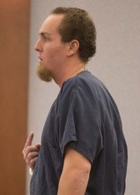 Before being sentenced for attempted robbery, Michael Belton makes comments to Judge Kathleen Delaney expressing his regret over the crime, Wednesday, Oct. 10, 2012, in Las Vegas. Belton received 2 to 5 years in state prison for a botched pepper spray grab-and-run casino chip heist at the Bellagio Hotel-Casino. (AP Photo/Julie Jacobson)