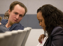 Michael Belton talks with his defense attorney Dedree Miles after his sentencing, Wednesday, Oct. 10, 2012, in Las Vegas.  Belton received 2 to 5 years in state prison for a botched pepper spray grab-and-run casino chip heist at the Bellagio Hotel-Casino. (AP Photo/Julie Jacobson)