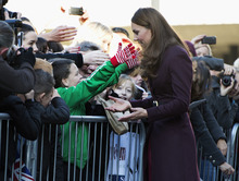 Terry Campbell, aged 10, asks Kate, The Duchess of Cambridge for a hug as she greets well wishers in the street during a visit to Newcastle Civic Center in Newcastle, England Wednesday, Oct. 10, 2012. The Duchess of Cambridge carried out a string of solo engagements in Newcastle Wednesday without the Duke, who is attending the funeral of his former nanny. (AP Photo/Paul Edwards, Pool)