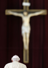 Pope Benedict XVI walks to the altar, during the weekly general audience in St. Peter's square at the Vatican, Wednesday, Oct. 10, 2012. (AP Photo/Alessandra Tarantino)