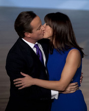 Britain's Prime Minister David Cameron kisses his wife Samantha after speaking at Britain's Conservative Party Conference, in Birmingham, England, Wednesday, Oct. 10, 2012. (AP Photo/Jon Super)