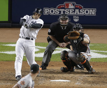 New York Yankees' Raul Ibanez hits a solo home run in the 12th inning in Game 3 of the American League division baseball series against the Baltimore Orioles on Wednesday, Oct. 10, 2012, in New York. The Baltimore catcher is Matt Wieters and the umpire is Brian Gorman. The Yankees won 3-2. (AP Photo/Peter Morgan)