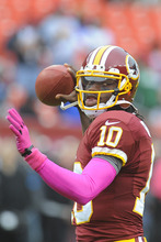 Washington Redskins quarterback Robert Griffin III warms up before an NFL football game against the Atlanta Falcons in Landover, Md., Sunday, Oct. 7, 2012. (AP Photo/Richard Lipski)