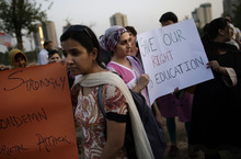 Pakistani women, hold banners during a protest condemning the attack on schoolgirl Malala Yousufzai, in Islamabad, Pakistan, Wednesday, Oct. 10, 2012. Pakistani doctors successfully removed a bullet Wednesday from the neck of a 14-year-old girl who was shot by the Taliban for speaking out in support of education for women, a government minister said. (AP Photo/Muhammed Muheisen)