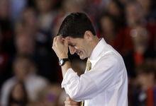 Republican vice presidential candidate, Rep. Paul Ryan, R-Wis., pauses while speaking at a rally at Oakland University in Rochester, Mich., Monday, Oct. 8, 2012. (AP Photo/Paul Sancya)
