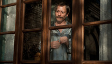 Violinist Nasser Ali Khan (Mathieu Amalric) confines himself to his bedroom to die, in the drama