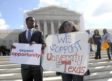 Jheanelle Wilkins of New Castle, Del., right, and Neo Moneri of Beltsville, Md., participate in a rally outside the Supreme Court in Washington, Wednesday, Oct. 10, 2012, supporting the University of Texas. The Supreme Court is taking up a challenge to a University of Texas program that considers race in some college admissions. The case could produce new limits on affirmative action at universities, or roll it back entirely. (AP Photo/Susan Walsh)