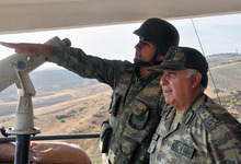 Turkish Chief of Staff Gen. Necdet Ozel, right, listens to a commander during his tour of the military along the border with Syria in Hatay, Turkey, Tuesday, Oct. 9, 2012. Prime Minister Recep Tayyip Erdogan said Tuesday Turkey was prepared to counter any threats from Syria.