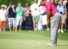 USA's Tiger Woods puts  during his World Golf Final match against Rory McIlroy in Belek, Antalya, Turkey, Wednesday, Oct. 10, 2012. (AP Photo)