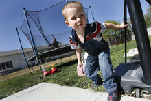 Scott Sommerdorf  |  The Salt Lake Tribune              Damien Cook plays in his backyard in Tremonton, Monday, October 1, 2012. The 3-year-old is among more than 260 Utah children with autism cuing up for limited spots in a free treatment program.