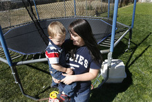 Scott Sommerdorf  |  The Salt Lake Tribune              Loreena Cook and her son Damien in their backyard in Tremonton, Monday, October 1, 2012. Cook is among over 260 parents seeking to enroll their children in a state-sponsored autism treatment program.