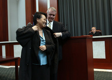 Francisco Kjolseth  |  The Salt Lake Tribune Andrew Stone performs the robing ceremony for his wife Judge Su Chon after she is sworn in as Utah's newest judge in the Utah Supreme Court at the Matheson Courthouse in Salt Lake City on Tuesday, October 9, 2012. Chon stirred controversy earlier this year by becoming the first judicial nominee in memory to fail to receive a favorable appointment from a Senate confirmation committee.