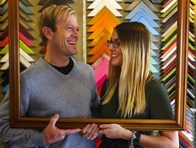 Leah Hogsten  |  The Salt Lake Tribune Phil Sherburne and Leia Bell, owners of Signed and Numbered, a custom frame and matting shop that sells screen prints and art, demonstrate one of their products.