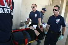 Leah Hogsten  |  The Salt Lake Tribune  Salt Lake City Fire Department's Craig Orum (left) and Jason Davis (right) take victim Allison Tripp to the treatment area where victims are re-assessed and evacuated according to injury and health. The Salt Lake City Fire Department spent the morning triaging dozens of victims from a shooting involving a single gunman at the Utah State Fairpark Wednesday, October 10, 2012.  The mock   drill was to train first responders and how they handle disasters and shooter scenarios.