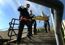 Leah Hogsten  |  The Salt Lake Tribune l-r Salt Lake City Fire Department's Mike Fox, Billy Oliver and Jason Davis carry out a