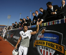 Rick Egan  |  The Salt Lake Tribune  BYU linebacker Kyle Van Noy (3) high-fives LDS missionaries after the Armed  Forces Bowl in Dallas last year. Athletes and coaches say the new age minimums for missionaries, lowered to 18 for boys and 19 for girls, will be nothing but a positive going forward.