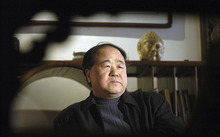 In this photo taken on Tuesday, Dec. 27, 2005, Chinese writer Mo Yan listens during an interview in Beijing, China. Mo was awarded the Nobel Prize in literature during a ceremony in Sweden on Thursday, Oct. 11, 2012. (AP Photo)
