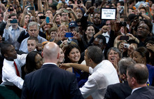 President Barack Obama shakes hands at a campaign event at the University of Miami, Thursday, Oct. 11, 2012, in Coral Gables, Fla. (AP Photo/Carolyn Kaster)