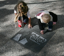 Steve Griffin   The Salt Lake Tribune  Nevaeh Wirick, 3, and Olivia Jean Bruno-Wirick, 16 months, touch the memorial for their great-grandfather, Richard Wirick, following an unveiling of the memorial on Gallivan Plaza in Salt Lake City on Thursday October 11, 2012. The permanent memorial is located in the heart of the city he helped promote. He had a vision of