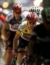 Trent Nelson  |  The Salt Lake Tribune Race leader Levi Leipheimer (in the yellow jersey) powers up State Street toward the state capitol building during Stage 4 of the Tour of Utah in Salt Lake City, Utah, Saturday, August 13, 2011.