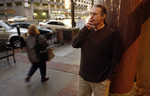 Bruce Dallas Goodman enjoys a smoke on his first day of freedom outside of his attorney's office in downtown Salt Lake on Tuesday after serving 19 years for a murder conviction vacated by new DNA evidence.     Photo by Francisco Kjolseth/The Salt Lake Tribune 11/09/2004
