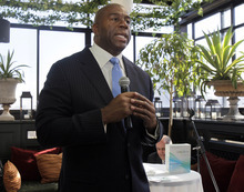 Former Los Angeles Lakers basketball player Magic Johnson speaks during the launch for Orasure Technologies' OraQuick, a new in-home rapid HIV test, on Wednesday, Oct. 10, 2012, in New York.  The company says OraQuick is the first and only rapid over the counter HIV test approved in the U.S.  In his role as product spokesman, Johnson, who tested positive for HIV in 1991, will help to increase
