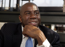 Former Los Angeles Lakers basketball player Magic Johnson is interviewed after he appeared at a presentation for Orasure Technologies' OraQuick HIV test, on Wednesday, Oct. 10, 2012, in New York.  The company says OraQuick is the first and only rapid over the counter HIV test approved in the U.S.  In his role as product spokesman, Johnson, who tested positive for HIV in 1991, will help to increase