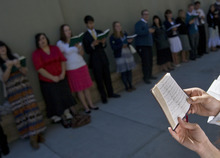 Kim Raff  |  The Salt Lake Tribune People sing hymns to people walking to conference during the 182nd Semiannual General Conference of the LDS Church in Salt Lake City on Sunday, October 7, 2012.
