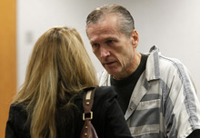 Al Hartmann  |  The Salt Lake Tribune Martin MacNeill,  a doctor accused of murdering his wife speaks to his defense lawyer Susanne Gustin in Judge Sam McVey's Fourth District Court in Provo Wednesday October 10 during his preliminary hearing.