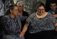 As Jessica's mother, Sarah Ridgeway begins to cry, she is comforted by her  aunt, Gay Moore, left, and by Sarah's great aunt Wendy Pesavento at the Westminster Police Department in Westminster, Colo., on Tuesday, Oct. 9, 2012. The family of Jessica Ridgeway gathered to talk about Jessica and ask for her safe return. Jessica went missing Friday while on her way to school. (AP Photo/The Denver Post, Kathryn Scott Osler, Pool)