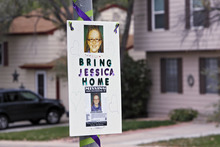 A missing person sign is posted on a lamp post near the home of ten-year-old Jessica Ridgeway where police continue to search for the missing girl in Westminster, Colo., on Wednesday, Oct. 10, 2012. The youngster has been missing since she left her home Friday morning on her way to school. (AP Photo/Ed Andrieski)