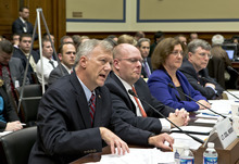 Lt. Col. Andrew Wood, left, a Utah National Guard Army Green Beret who was the top security official at the United States consulate in Libya, answers questions as the House Oversight and Government Reform Committee investigates the Sept. 11, 2012, attack on the American consulate in Benghazi, Libya, that resulted in the death of U.S. Amb. Christopher Stevens and other Americans, on Capitol Hill in Washington, Wednesday, Oct. 10, 2012. From left to right are Lt. Col. Andrew Wood, Eric Nordstrom, a regional security officer with the State Department, Charlene Lamb, deputy assistant secretary for international programs at the State Department's Bureau of Diplomat Security, and Amb. Patrick Kennedy, under secretary for management at the State Department. (AP Photo/J. Scott Applewhite)