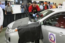 Courtesy Ally Curran Chris Smith of Technaglass in Draper, repairs a break in a windshield during the Walt Gorman Memorial Windshield Repair Competition Finals in Louisville, Ky., last month. Smith placed second in the competition.