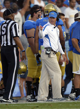 UCLA head coach Jim Mora, right, gestures to an official during the first half of their NCAA football game against Nebraska, Saturday, Sept. 8, 2012, in Pasadena, Calif.  (AP Photo/Mark J. Terrill)