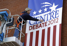 Centre College carpenter Damon Denney hangs a sign outside the Norton Center in preparation for Thursday night's vice presidential debate, Wednesday, Oct. 10, 2012, in Danville, Kentucky. (AP Photo/Charlie Neibergall)