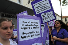 In this photo taken Tuesday, Oct. 9, 2012, abortion rights activists protest outside a hospital in Buenos Aires, Argentina, after a judge intervened in the scheduled abortion of a woman rescued from a prostitution ring. Argentina's Supreme Court ruled Friday, Oct. 12, 2012, that the 32-years old woman must be allowed to have the abortion she wants. Argentina allows legal abortions in rape cases or to protect a woman's health. But politicians, doctors and judges often continue to block them. (AP Photo/ Raul Ferrari, Telam)