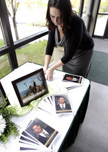 Francisco Kjolseth  |  The Salt Lake Tribune Jennifer Jones, cousin of slain border patrol agent Nicholas Ivie, a Provo native, arranges photos and programs at the UCCU Center at Utah Valley University in Orem on Thursday, October 11, 2012, prior to services.